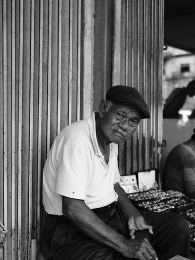 Portrait of mature man selling rings at market