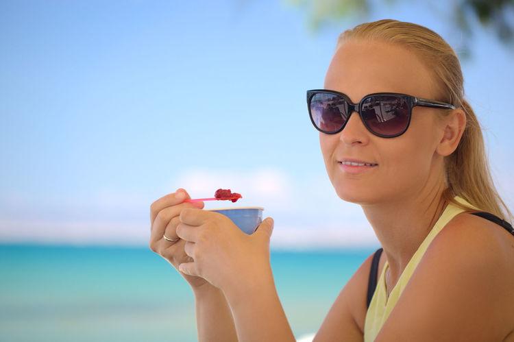 Beach Caucasian Dessert Eat Food Girl Horizontal Ice Cream Ice-cream Looking At Camera Refresh Resort Rest Seaside Sunglasses Sweet Tasty Woman Young Women