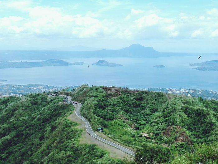 Mountain road against sea