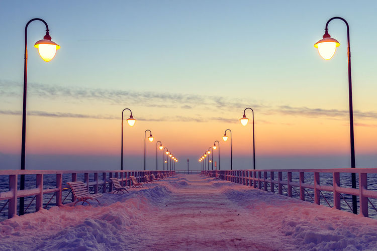 Winter sunrise at the pier of Orlowo. Architecture Day Dengler Dramatic Sky Gdynia Ice Landscape Lights Matthias No People Orłowo Outdoors Photography Pier Poland Sky Snapshopped Snow Snow ❄ Sunrise Sunset Travel Vacations Winter