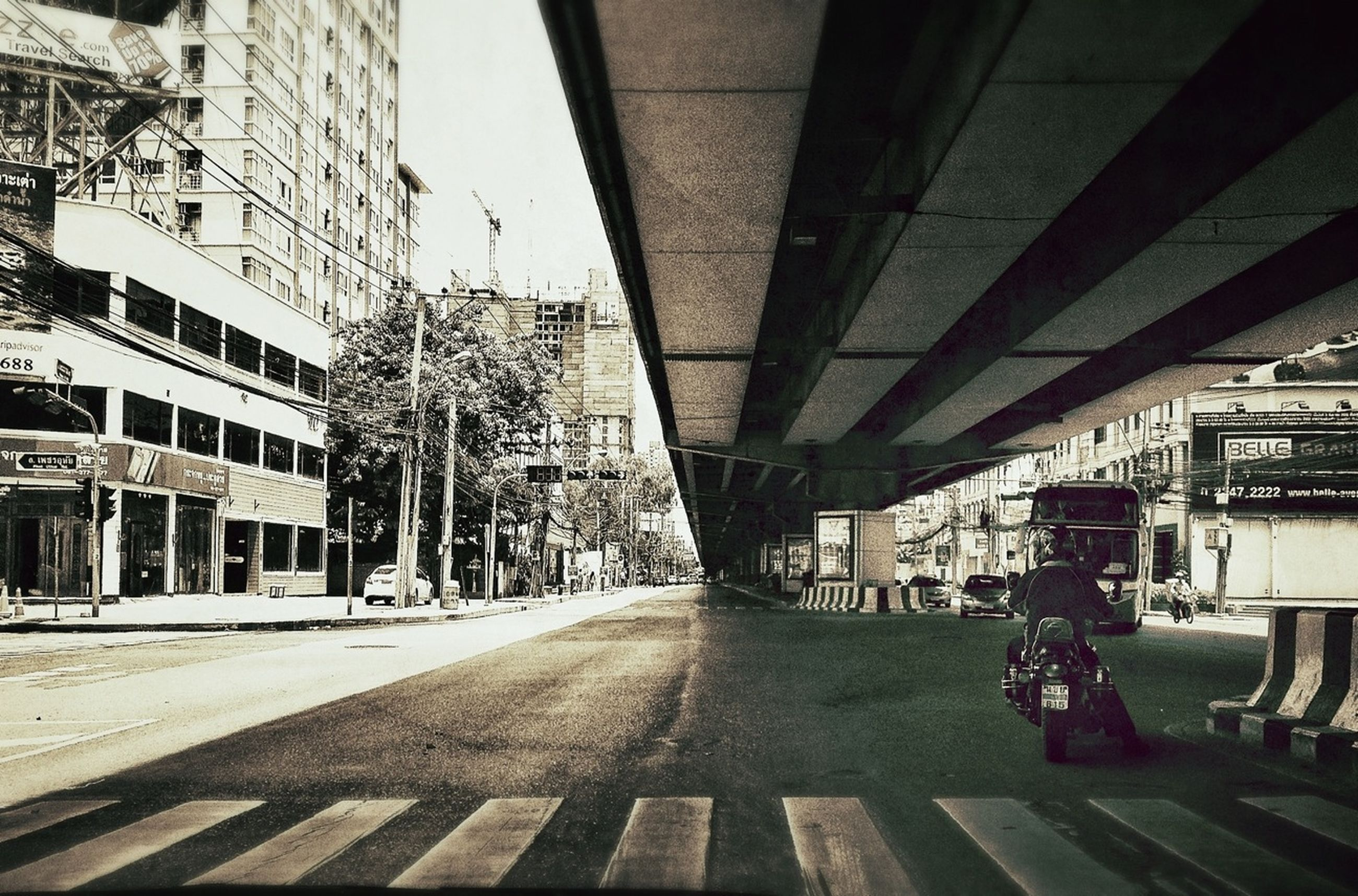 architecture, built structure, building exterior, the way forward, city, transportation, diminishing perspective, building, vanishing point, incidental people, street, city life, day, residential building, residential structure, outdoors, empty, sunlight, railroad track, no people