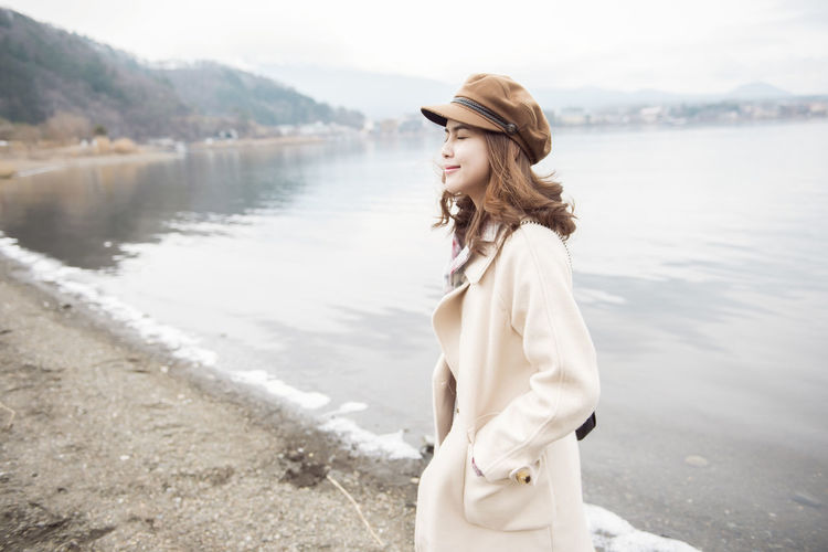 Water Young Adult One Person Young Women Side View Standing Clothing Leisure Activity Beautiful Woman Beauty Lifestyles Adult Women Nature Hat Hairstyle Hair Fashion Outdoors Contemplation Looking Over Shoulder