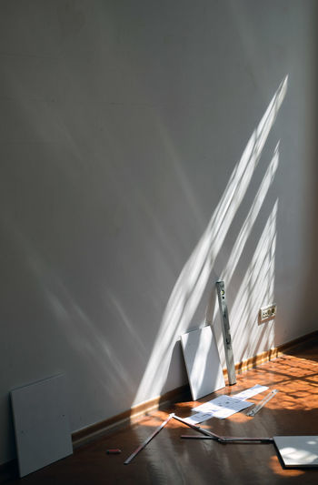Indoors  No People Shadow Copy Space Day Furniture Light Beam Wall - Building Feature Level Window Shadow Interior Relaxing Creativity Art Studio Gallery Exhibition Set Up