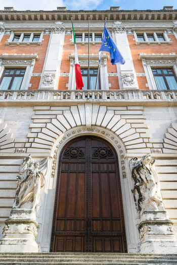 Statue Sculpture Architecture Palazzo Montecitorio Government Parlament Camera Dei Deputati Rome Italy Politics And Government Patriotism Flag Window Politics And Government Door Architecture Building Exterior Built Structure Historic Arch Archway Entryway History Building Entrance Arched Exterior