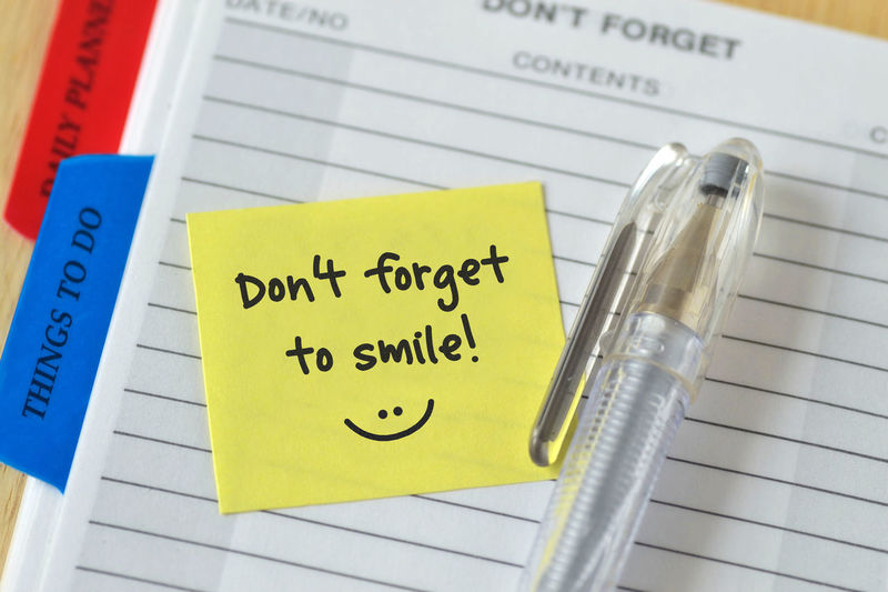 Text don't forget to smile written on a sticky note over agenda background Don't Forget To Smile Funny Happy :) Positive Slogan Sticker Thinking Abstract Concept Diary Emoticon Forget Handwriting  Invitation Memo Message Note Notepaper Optimism Positive Thinking Positivity Post-it Quote Smile Sticky