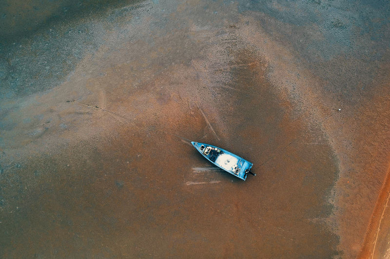 High angle view of boat moored at beach