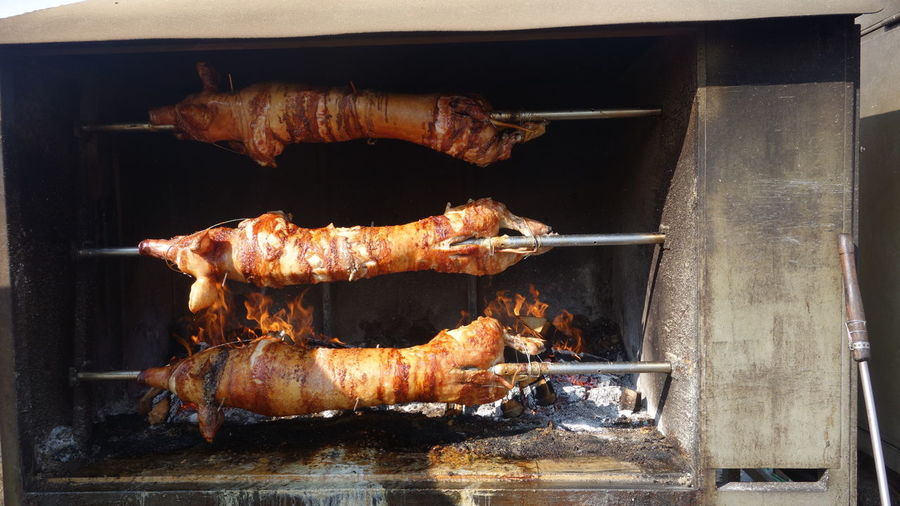 High angle view of roast pork on barbecue