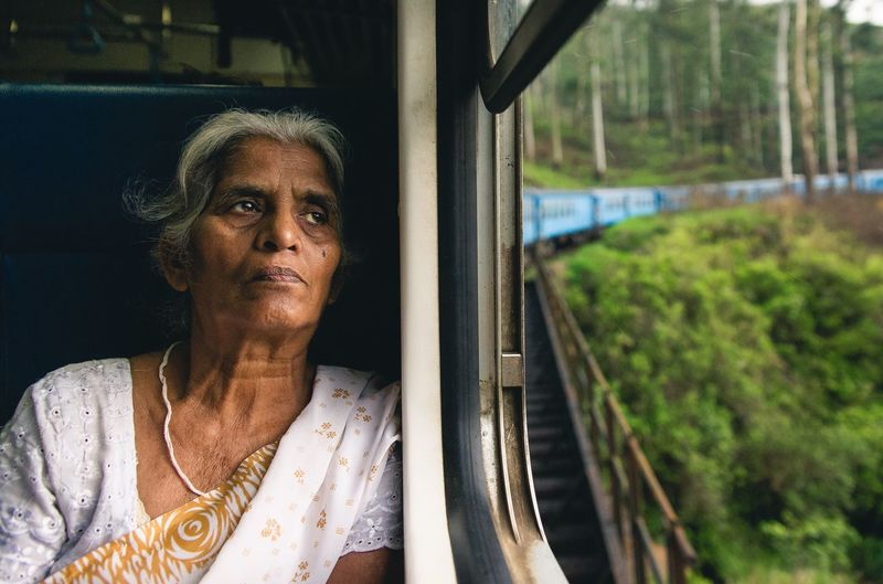 The Journey Is The Destination One of my favorite photos I took from my trip Portrait Portrait Of A Woman Train Rise Portraiture PortraitPhotography Streetphotography Travel Travel Photography SriLanka Sony A850 Showcase July People And Places The Portraitist - 2017 EyeEm Awards
