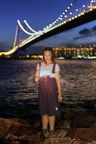 Fireworks in Sai Tso Wan, Tsing Yi EyeEmNewHere Fireworks Night Lights Sai Tso Wan Tsing Yi Twilight Architecture Beautiful Woman Bokeh Bridge - Man Made Structure Casual Clothing Connection Eye4photography  Front View Full Length Illuminated Leisure Activity Lifestyles Looking At Camera Nature Night One Person Outdoors Real People Sky Standing Water Young Adult Young Women 滴滴金 滴滴金煙花 煙花 茜草灣 西草灣 青衣