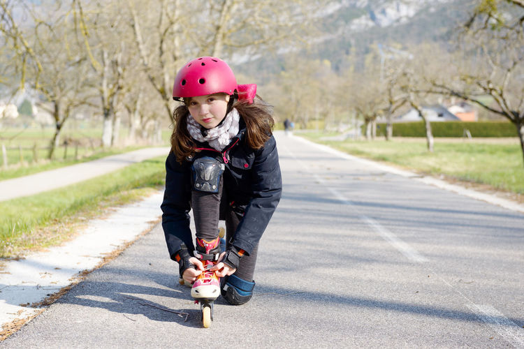 Casual Clothing Child Childhood Day Emotion Females Front View Full Length Happiness Innocence Leisure Activity Looking At Camera Nature One Person Outdoors Portrait Road Smiling Transportation Warm Clothing