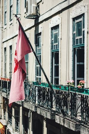 Pink flag Flag Building Exterior Architecture Built Structure Patriotism Railing Window Balcony Outdoors No People Low Angle View Pink Pink Flag Lisbon Lisboa Portugal Portuguese Portuguese Architecture Travel Photography Selective Focus Streetphotography Symbol Randomness Colour Of Life Exterior
