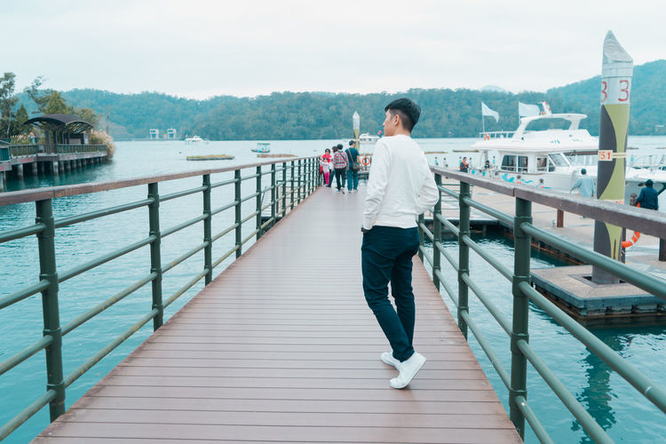 Railing Full Length Architecture One Person Real People Built Structure Lifestyles Water Leisure Activity Nature Day Casual Clothing Mountain Adult Standing Young Adult Women Connection Outdoors