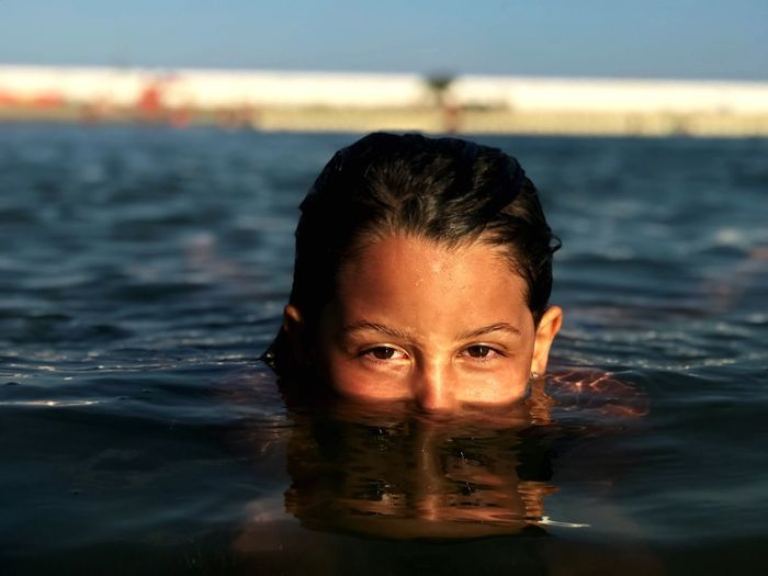 Water Portrait One Person Headshot Looking At Camera Leisure Activity Waterfront Sea Human Face Swimming Beautiful Woman Young Adult Lifestyles First Eyeem Photo My Best Photo 17.62°