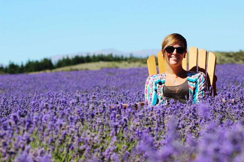 Portrait Of Woman Sitting In Lavender Field