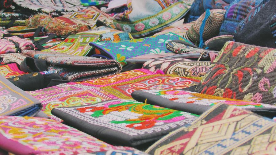 Close-Up Of Embroidered Bags Displayed For Sale