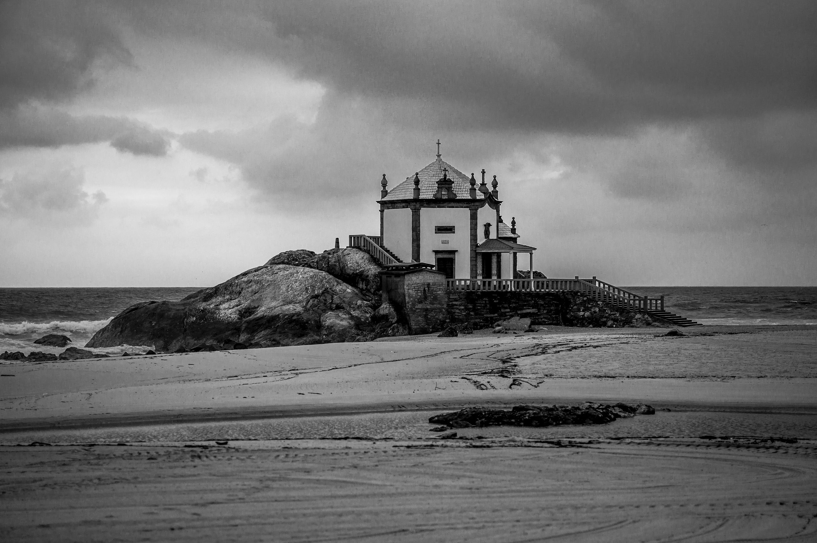 sea, sky, beach, horizon over water, lighthouse, water, built structure, architecture, shore, building exterior, guidance, sand, cloud - sky, tranquil scene, scenics, tranquility, nature, protection, beauty in nature, direction