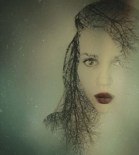 Close-up portrait of young woman in water