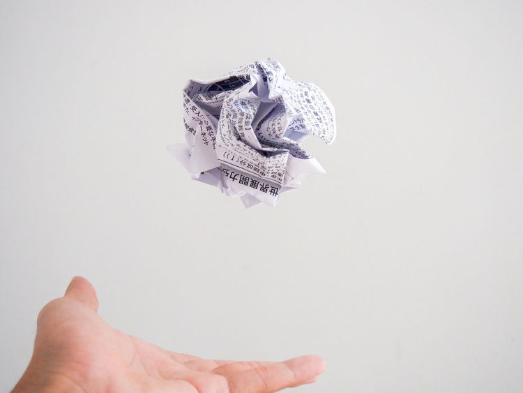 Isolated hand throwing a white paper ball with Japanese text Abstract Ball Conceptual Crumble Crushed Equipment Garbage Hand Idea Isolated Japanese  Office Paper Rough Rubbish Sphere Studio Shot Text Textures And Surfaces Throw Trash Used White Background Wrinkles