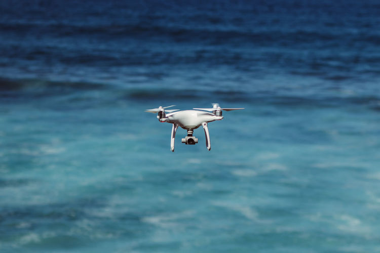 Travel buddy Outdoors Beauty In Nature Swimming Nature Flying Motion No People Blue Water Sea Waterfront Drone  Camera Equipment