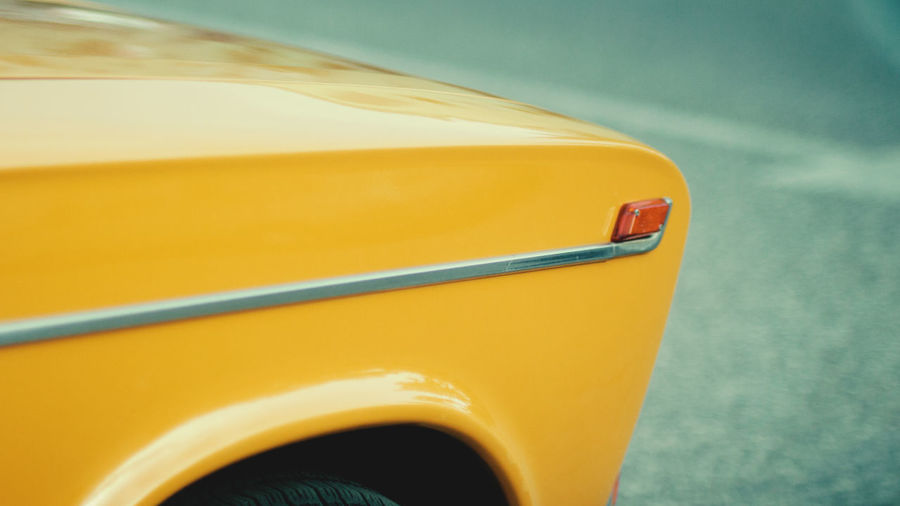 Close-up of yellow car