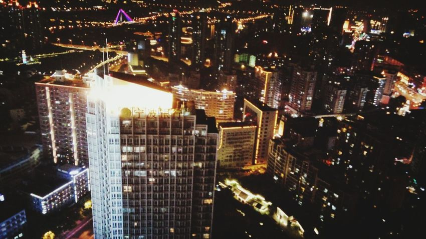Cityscape City Skyscraper Illuminated Night Architecture Building Exterior Modern Urban Skyline City Life High Angle View Aerial View Downtown District Outdoors Long Exposure No People Travel Destinations Growth Built Structure Sky