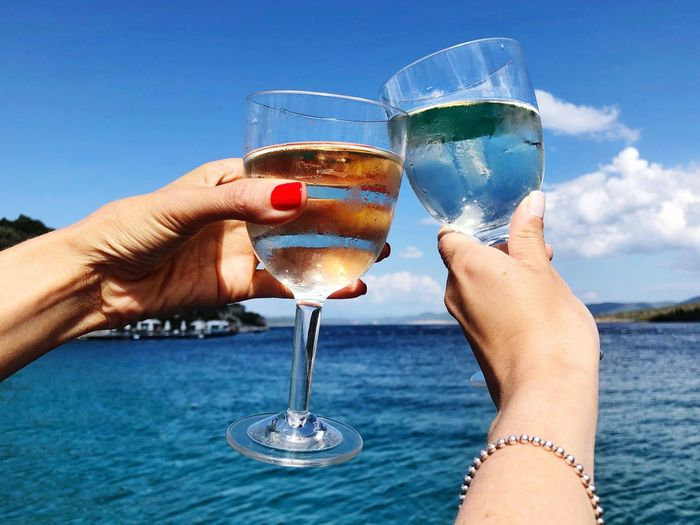 Wine Summer Refreshment Glass Drink Human Hand Alcohol Water Hand Drinking Glass Sky Holding Real People Day Freshness Wineglass Cocktail
