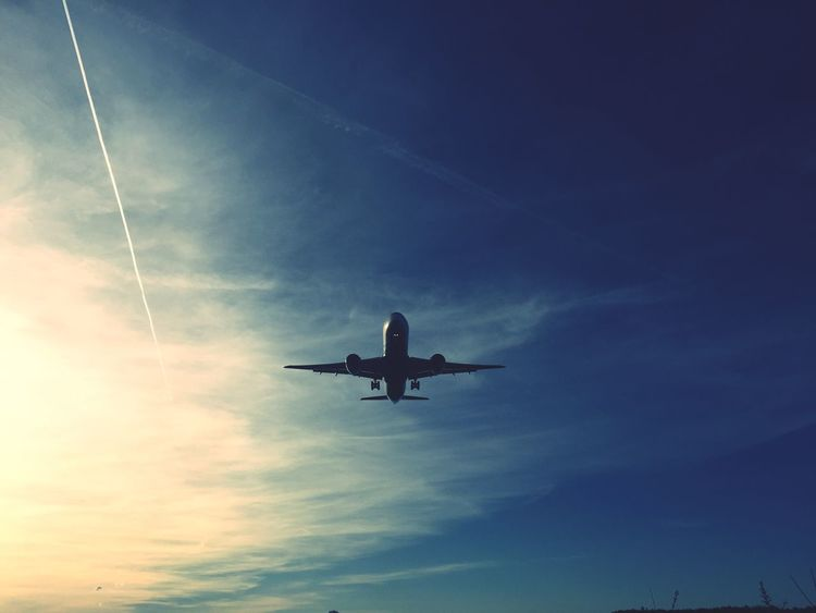 Airplane Low Angle View Transportation Sky Flying Travel Journey No People Blue Vapor Trail Outdoors Day
