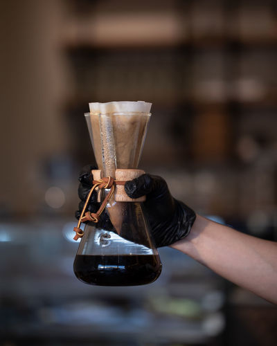 Black Coffee inside Lab Glass in Hand Ijas Muhammed Photography Human Hand Human Body Part Holding Hand One Person Focus On Foreground Real People Occupation Working Indoors  Body Part Drink Equipment Close-up Food And Drink Unrecognizable Person Glass Adult Coffee - Drink Human Limb