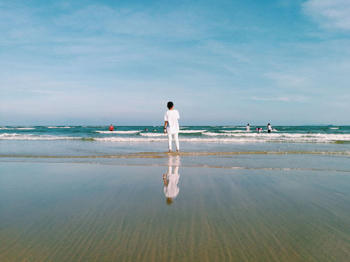 Full Length Outdoors Reflection One Person Beach Standing Young Adult Nature Sea Sky People Mobile Phone Photography Smartphone Photography Huawei P9 Leica Looking At The Sea Day White Clothes Water Sand Beach View