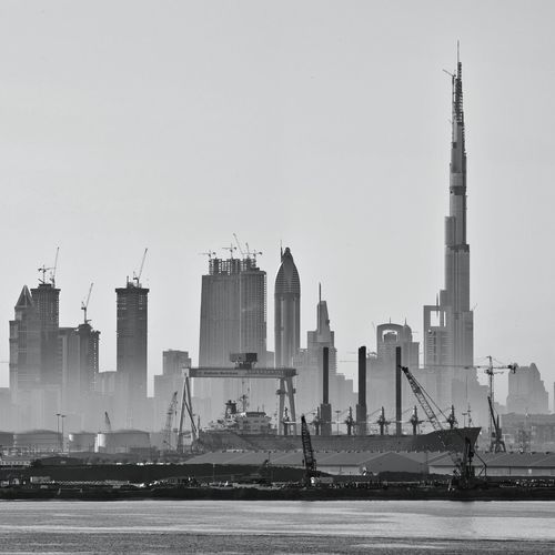 City skyline with burj khalifa against clear sky