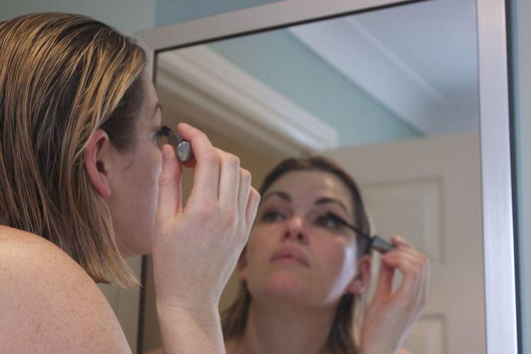 woman applying makeup Reflection Morning Routine Bathroom Woman Putting On Makeup Putting On A Fresh Face... Applying Mascara Applying Makeup
