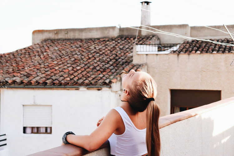 Full length of woman on roof of building