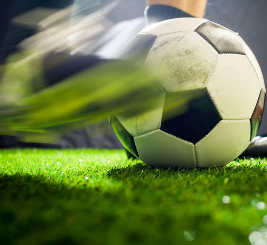 Close-up of soccer ball on field