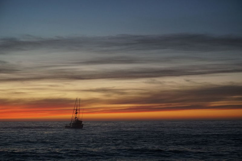 Sunset at the Beach Sky Collection sunset Sea Nautical Vessel Horizon Over Water Sky Cloud - Sky Silhouette Fishing Boat Sunset Moss Landing, CA