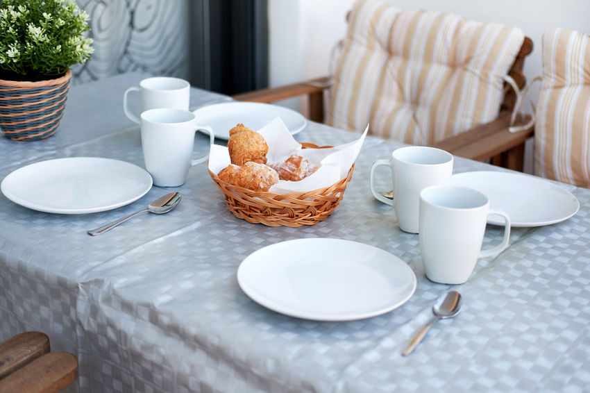 Table setting with a cups, plates and pastries Breakfast Table Setting Table Arrangements Tableware Breakfast Chair Chairs Close-up Coffee - Drink Coffee Cup Day Drink Food Food And Drink Indoors  No People Nobody Pastries Pastry Plate Ready-to-eat Sweet Food Table Table And Chairs Table Set