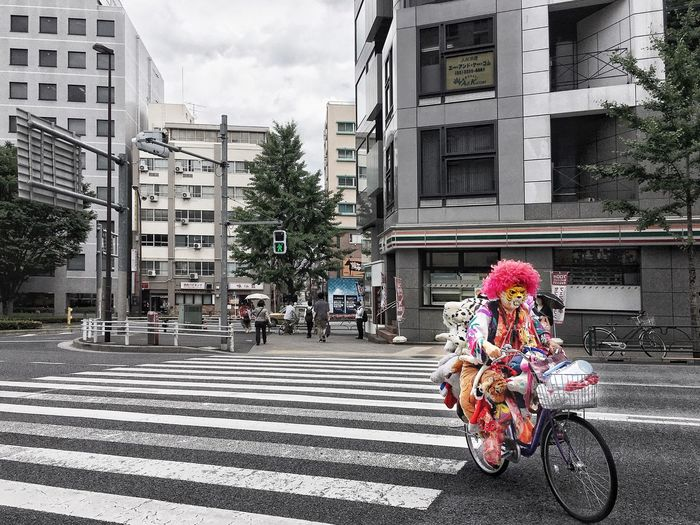 Bicycles on road against buildings