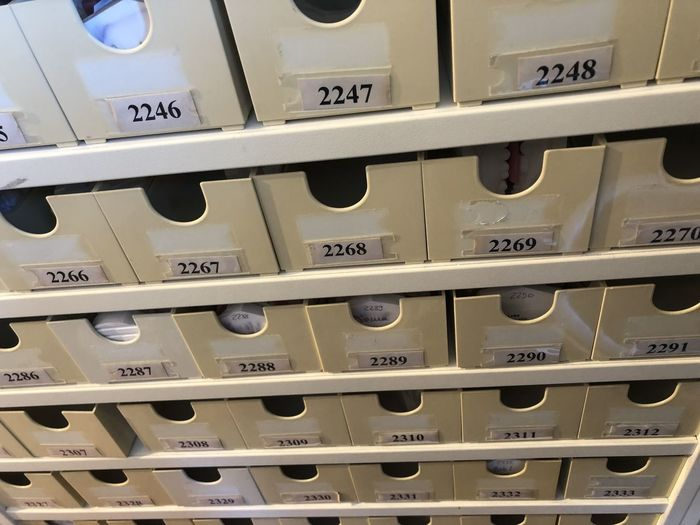 In A Row Full Frame Indoors  No People Backgrounds Close-up Communication Metal Number Repetition Side By Side Technology Large Group Of Objects Text Order Store Pattern Abundance Business Safety Silver Colored