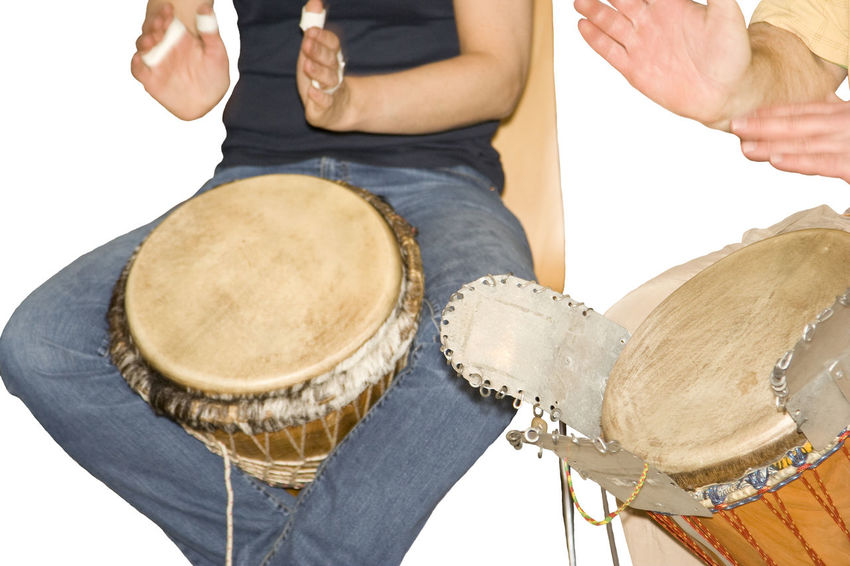 two men playing djembe - african drum Adults Only African Bongo Clapping Hands Close-up Communication Djembe Drum Drummer Drumming Drums Hitting Instrument Isolated Isolated On White Men Midsection Music Musician Percussion Rhythm Togetherness Two People Unrecognizable Person White Background