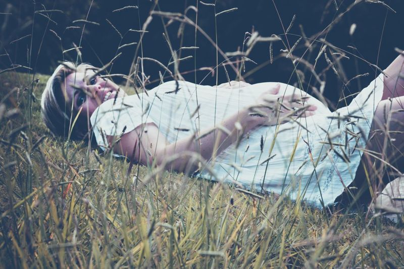 Woman lying on field