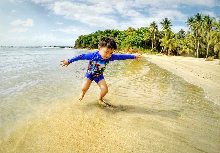 Enjoying The Beach My Son ❤ Inner Power Water Child Full Length Males  Childhood Boys Beach Sand Motion Summer Jumping Energetic Shore