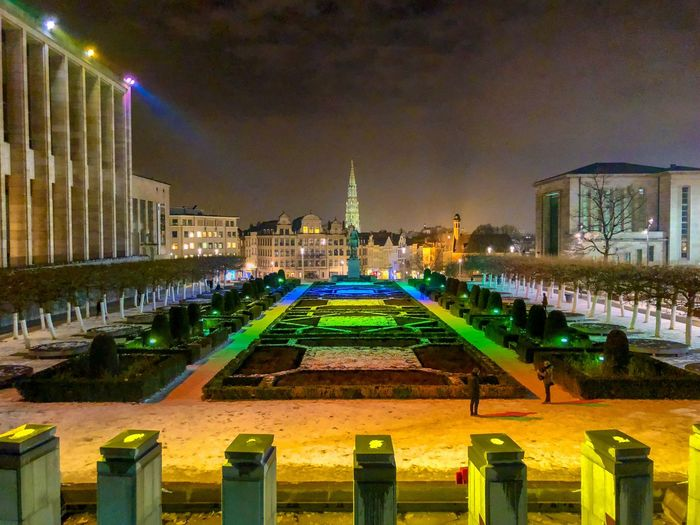 Mont des arts in Brussels, Belgium, as seen at night in januari 2019, with the colorful lights over the garden, and a view over the old city Architecture Night Built Structure Illuminated Building Exterior Travel Destinations No People Sky City Travel Nature Park Outdoors Park - Man Made Space Tourism Architectural Column Building History Plant Skyscraper