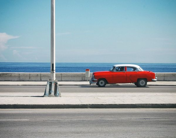 The Drive Sea Car Transportation Horizon Over Water Sky Red Road Land Vehicle Day Water Outdoors Beach Stationary Nature No People Beauty In Nature Classic Classic Car Havana Cuba Been There.