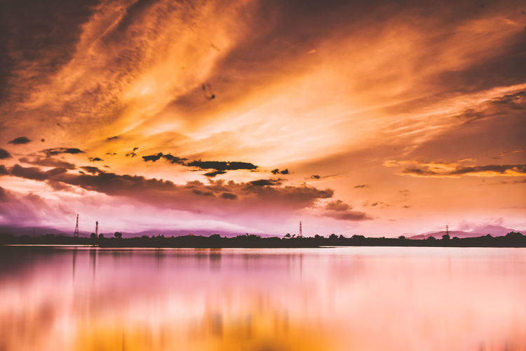 Beauty In Nature Cloud - Sky Dramatic Sky Idyllic Lake Nature No People Non-urban Scene Orange Color Outdoors Purple Reflection Romantic Sky Scenics - Nature Silhouette Sky Sunset Tranquil Scene Tranquility Water Waterfront