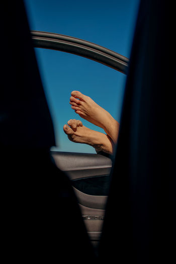 One Person Real People Window Indoors  Lifestyles Body Part Transportation Close-up Unrecognizable Person Selective Focus Human Limb Human Body Part Finger Midsection Motor Vehicle Vehicle Interior Land Vehicle Mode Of Transportation