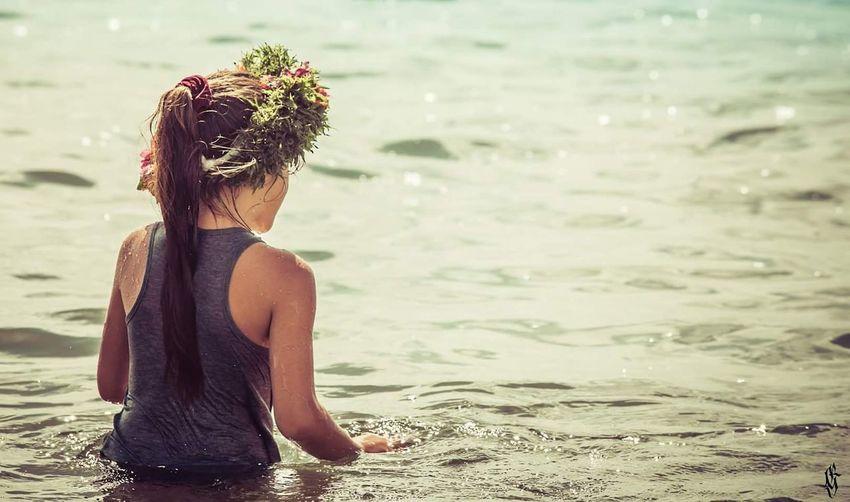 Female friends enjoying in sea
