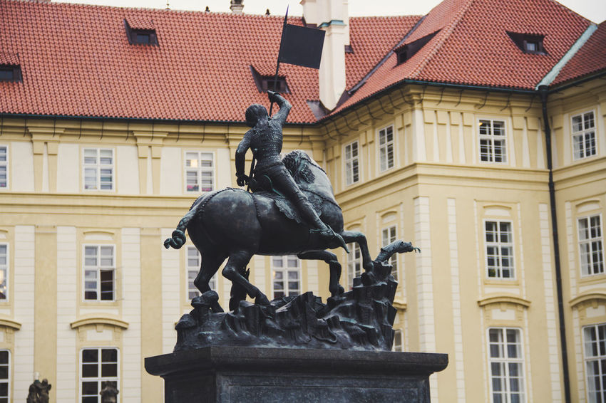 Prague Praha Architecture Art And Craft Building Building Exterior Built Structure City Creativity Day History Horse Human Representation Male Likeness No People Outdoors Sculpture Sky Statue