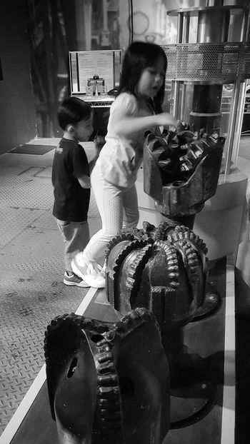 Oil Drilling Science And Technology Girl Boy Excited Siblings Indoors  Happiness Cute Children The Eyeem Of Week Fun Travel Petrosains Unschooling Homeschooling Childhood Kid Science Museum  Smile Smiling Innocence Of A Child Black And White Education Visiting Museum