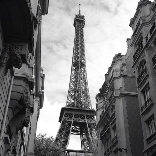 Exterior Of Buildings Against Eiffel Tower