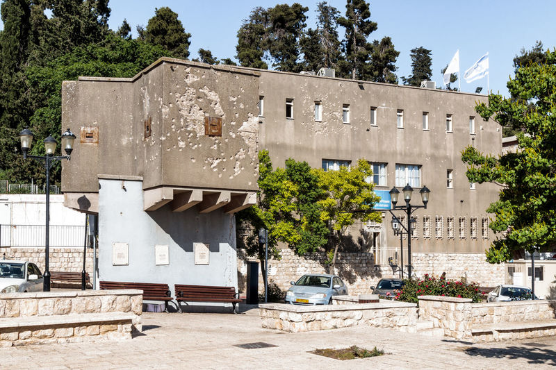 The building in the city of Safed (Tzfat) with traces of bullets and shells that have been left since the Independence war 1948 of Israel 1948 Army British Building Bullet Defence Fire Galillee Hebrew Heritage Historic House Independence Israel Jewich Legion Moument Muslim Safed Shells Stone Time Traces Victory War