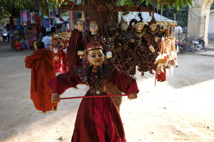 String Puppets Buddhism Buddhist Culture Buddhist Tradition Close Up Composition First Eyeem Photo For Sale Front View Full Frame Market Stall Mingun Myanmar No People Outdoor Photography Souvenirs String Puppets Sunlight And Shade Traditional Costumes Traditional Culture